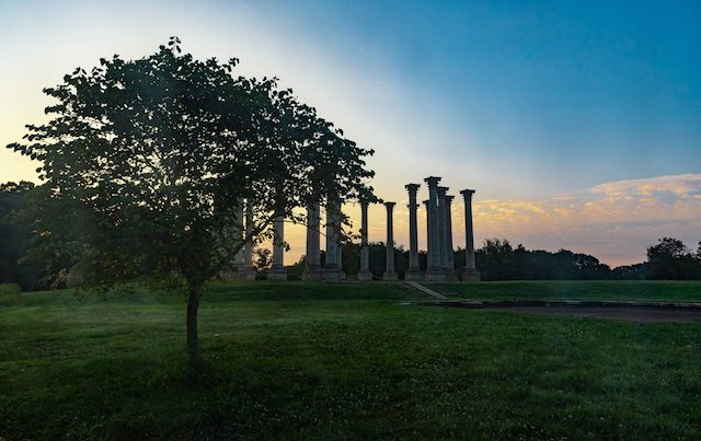 Moonset and Sunrise Over National Capitol Columns-Jeff McQuilkin